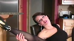 Chick in darksome pantyhose drills her pussy with a toy