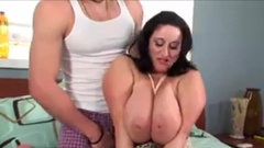 Busty MILF with Huge Tits Rides Cock
