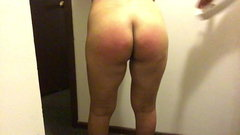 Spanking Latina wife with a belt