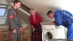 Old grandma spreads legs for two repairmen