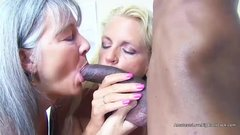 Two tanned matures invite a black guy round and share his big black dick