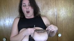 Chastity uses the SPIKED titty smashers!
