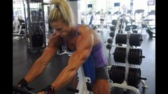 beautiful muscular milf working out back in gym